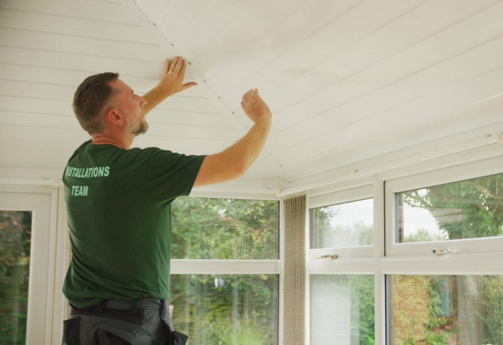 man working on conservatory roof