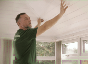 Image of Fitter installing conservatory insulation